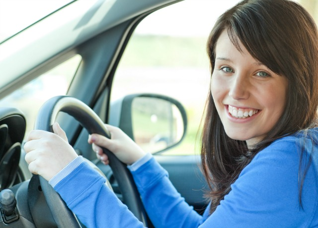Happy young female driver